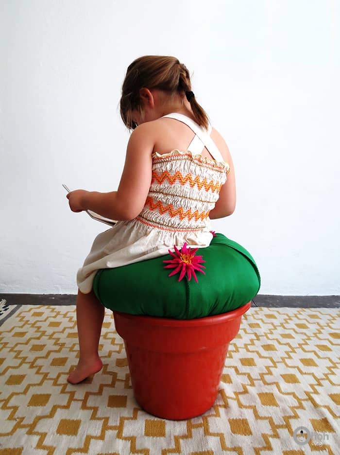 sitting on cactus pouf