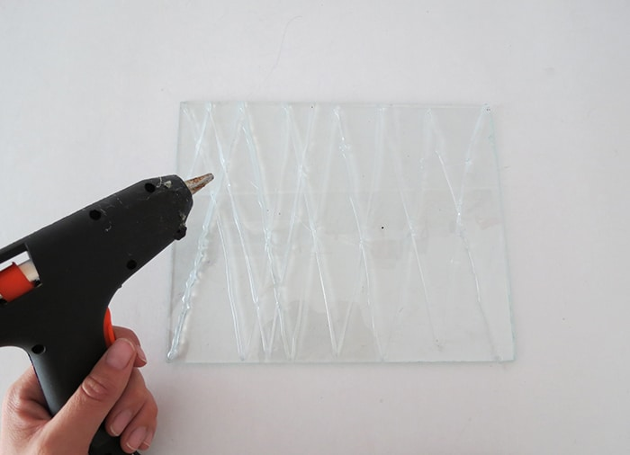 spreading hot glue