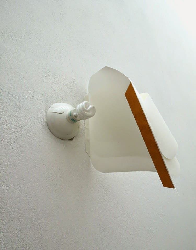 placing paper lamp on the wall