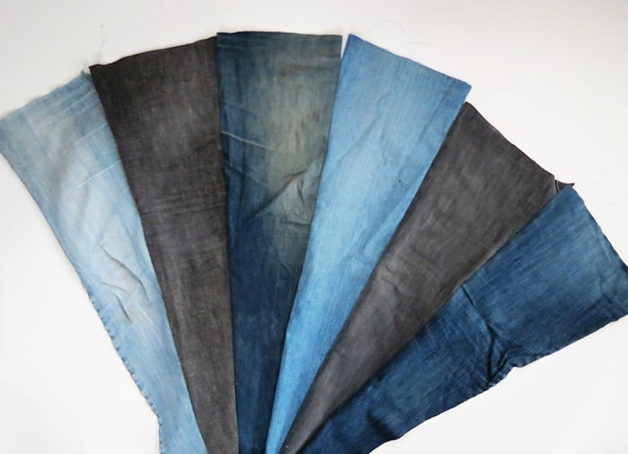 sewing pieces to make a denim rug
