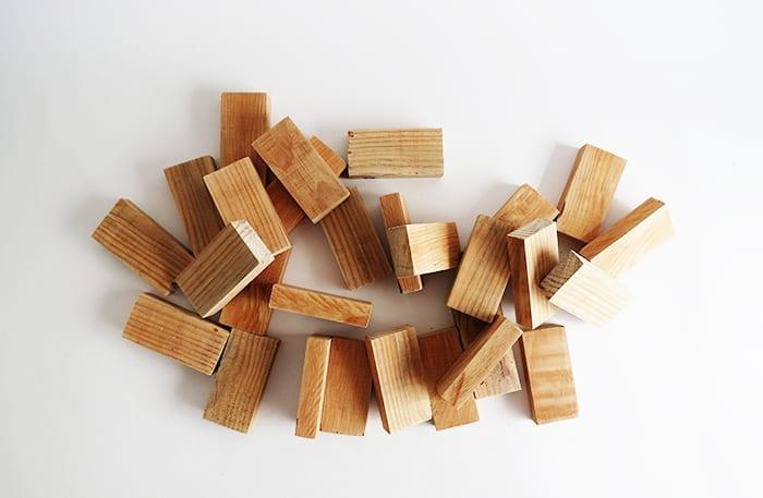 cut lumber to make diy dominoes